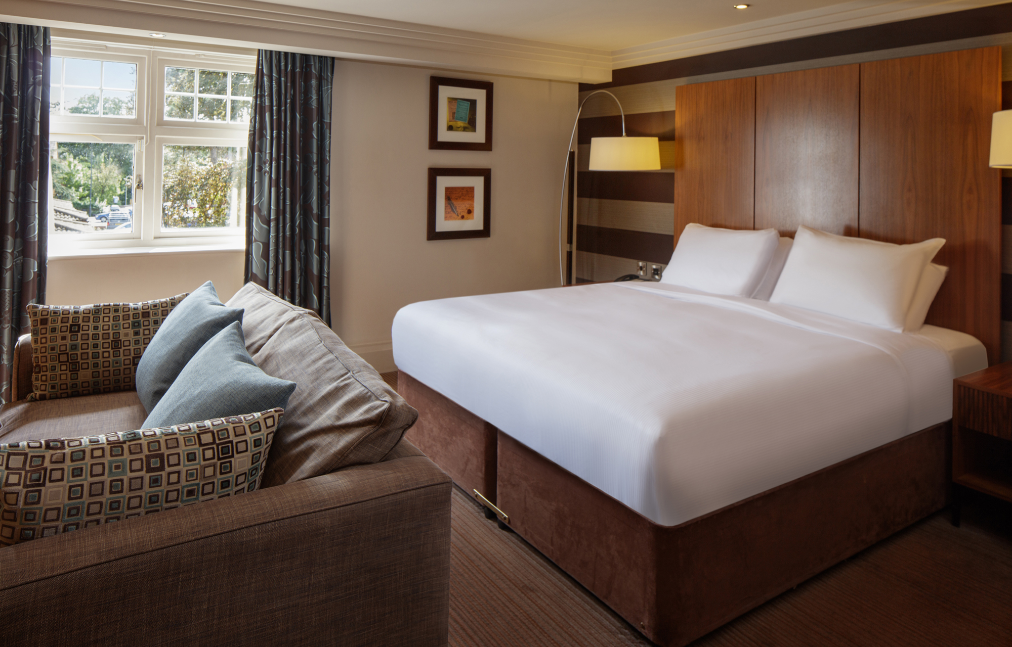bedroom and sofa doubletree by hilton stratford-upon-avon