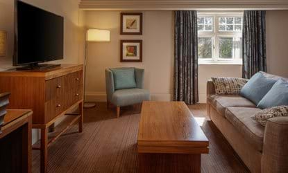 bedroom lounge area sofa tv doubletree by hilton stratford-upon-avon